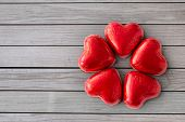 valentines day, sweets and confectionery concept - close up of red heart shaped chocolate candies ov poster