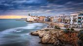 Sunset Over Sitges, Catalunya, Spain. Sitges Is A Famous Town Near Barcelona, Famous For Its Nightl poster