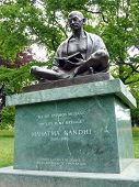 picture of gandhi  - Statue of Mahatma Gandhi sitting and reading a book in the Ariana park Geneva Switzerland - JPG