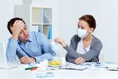 stock photo of rhinitis  - Image of sick businessman looking at his partner in mask offering him to put on one in office - JPG