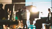 Blurred Images Of Behind The Scenes Of Filming Or Movie Shooting poster