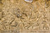 stock photo of mahabharata  - An ancient bas relief frieze on a wall of Angkor Wat Temple in Siem Reap - JPG