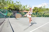 image of deuce  - view of female  tennis player on  color back - JPG