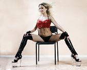 stock photo of stripper shoes  - Stripper on chair - JPG