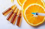 Vitamin C, Natural Anti Aging Cosmetics Serum Ampullas And Syringe poster