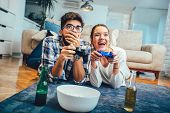 Cute Couple Playing Video Games At Home poster