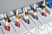 The Electrical Wires Are Connected To Circuit Breakers Or Fuse Holders. The Cables Have Insulated Te poster