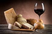 stock photo of wood pieces  - variety of cheese and red wine - JPG