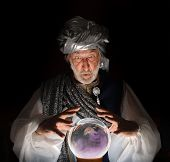foto of clairvoyant  - A picture of a Swami gazing into a crystal ball - JPG