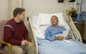 picture of hospital patient  - Son visiting his Dad in the hospital - JPG