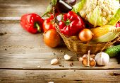 image of wooden basket  - Healthy Organic Vegetables on a Wooden Background - JPG