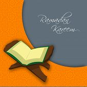 pic of islamic religious holy book  - Holy month of muslim community of  Ramadan Kareem with open islamic religious holy book Quran Shareef on orange and grey background - JPG