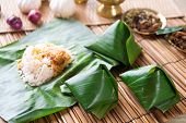 Nasi lemak, popular traditional Malaysia food wrapped with banana leaf.