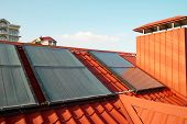 Alternative Energy- Solar System On The House Roof. poster