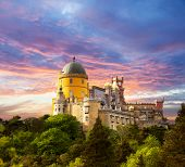 foto of yellow castle  - Fairy Palace against sunset sky  - JPG