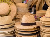 stock photo of headgear  - selection of straw hats - JPG