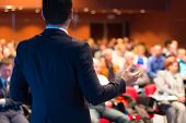 image of speaker  - Speaker at Business Conference and Presentation. Audience at the conference hall.