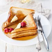 image of french-toast  - French toast with raspberries maple syrup and butter - JPG