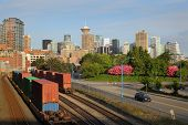 stock photo of inlet  - The city skyline view past the Port of Vancouver railyard on Burrard Inlet - JPG