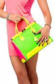 pic of mini dress  - Closeup of woman with neon green and pink bag - JPG