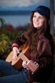 Beautiful Teenager Playing Guitar