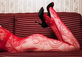 picture of fetish fishnet stockings  - woman lying on the couch - JPG