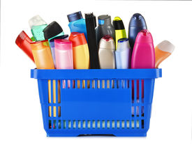 stock photo of body-lotion  - Plastic shopping basket with plastic bottles of body care and beauty products - JPG