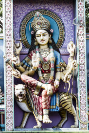 image of durga  - Monument of Hindu Goddess Durga seated on a roaring Lion her vahana or vehicle at the temple entrance wall