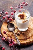 foto of pecan nut  - Glass Of Delicious Yogurt Muesli With Pecan Nuts On Wooden Background - JPG