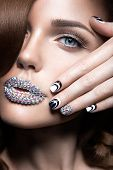 foto of long nails  - Beautiful girl with bright nails and lips of crystals - JPG