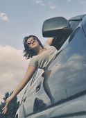 picture of car ride  - Girl looks out the window when riding in a car - JPG