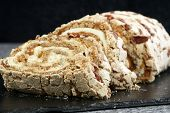 image of pecan nut  - meringue roulade with fresh cream toffee and pecan nuts - JPG