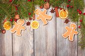 foto of hazelnut tree  - Gingerbreads and fir tree branches on the wooden table - JPG