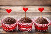 stock photo of chocolate muffin  - chocolate muffins on dark wood background for Valentine - JPG