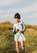 image of shy girl  - Shy little girl on the beach in a sunny day - JPG