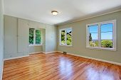 foto of master bedroom  - Empty master bedroom interior with windows hardwood floor and built in wardrobe - JPG