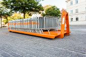 pic of movable  - movable fences stand on a platform of a truck in the middle of a square - JPG