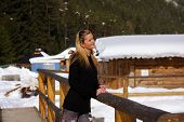 pic of bannister  - A beautiful young blonde lady in a snowy winter landscape - JPG