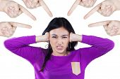picture of bullying  - Portrait of angry teenage girl and close her ears when bullied by her classmates - JPG
