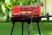 foto of frizzle  - Horizontal view of sausages on charcoal grill - JPG
