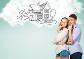 picture of family planning  - Young happy family couple dreaming of future wealthy life - JPG