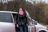 picture of pink eyes  - Girl with pink scarf get out from pink car - JPG