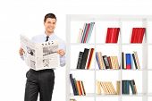foto of newspaper  - Man holding a newspaper and leaning against a bookshelf ATTENTION !!!  The newspaper is custom made, the text is Latin and the pictures are my copyright.  - JPG