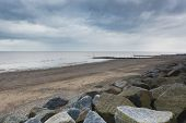 pic of breaker  - Concrete sea defences and wave breakers on Withernsea Beach East Yorkshire UK environmental issues - JPG