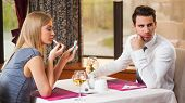 stock photo of boring  - Young couple is getting bored and on first date