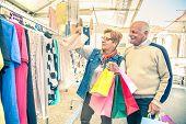 stock photo of wardrobe  - Mature woman looking clothes at market  - JPG