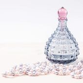 picture of perfume  - Blue glass bottle of female perfume and Pearl beads - JPG
