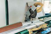 stock photo of sawing  - Circular Saw Blade Cutting PVC Window Profile - JPG