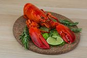 stock photo of lobster tail  - Boiled lobster served with thyme and rosemary - JPG