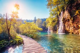 picture of nationalism  - Majestic view on turquoise water and sunny beams in the Plitvice Lakes National Park - JPG